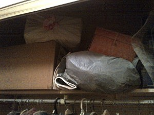 Boxes stacked in a closet