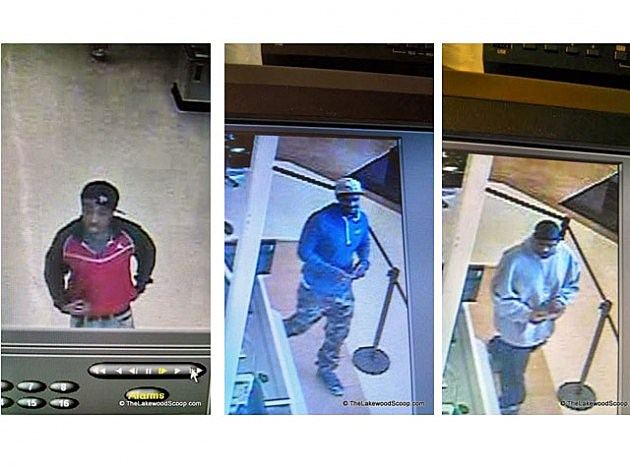 Screen shot of video surveillance showing suspects involved with the use of a stolen credit card in Lakewood