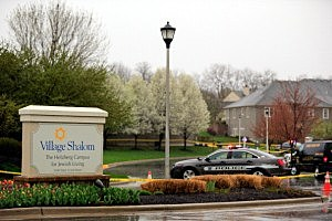 Police cars sit outside Village Shalom, the senior living center where one of three victims was killed when a gunman opened fire in Leawood, Kansas