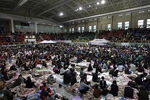 Relatives wait for missing passengers of a sunken ferry at Jindo gymnasium in Jindo-gun, South Korea