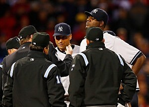 ome plate umpire Gerry Davis checks out a substance on the neck of Michael Pineda #35 of the New York Yankees before throwing him out of the game in the second inning against the Boston Red Sox
