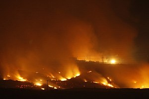 The Las Pulgas Fire lights the night at Camp Pendleton, California