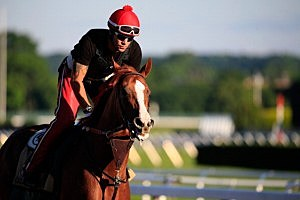 Kentucky Derby and Preakness winner California Chrome, with exercise rider Willie Delgado at Belmont