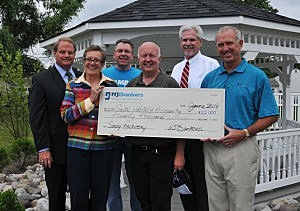 (L-R) Workers of Manasquan Savings, Coastal Habitat for Humanity, Amboy Bank, Neptune township, Two River Community Bank and New Jersey Bankers Association President/CEO John E. McWeeney, Jr. (Donald Christensen
