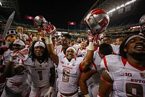 Members of the Rutgers Scarlet Knights celebrate after defeating the Washington State Cougars 41-38 at CenturyLink Field in Seattle