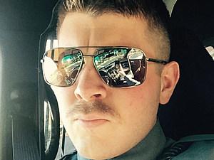 Patrolman Nicholas Saltzman, with hair and care