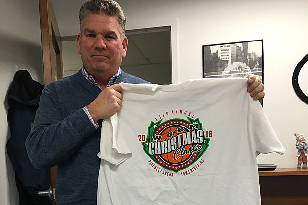 Kevin Williams holds a 2016 WOBM Christmas Classic T-shirt