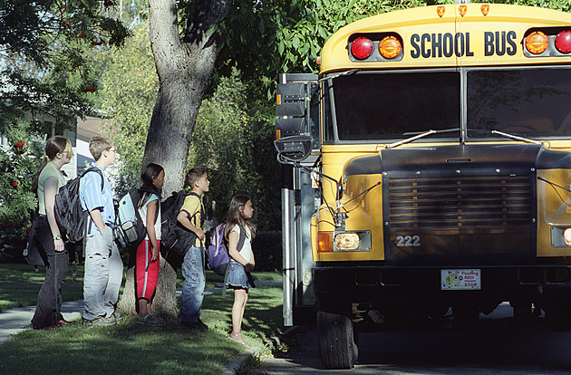 Children loading a school bus