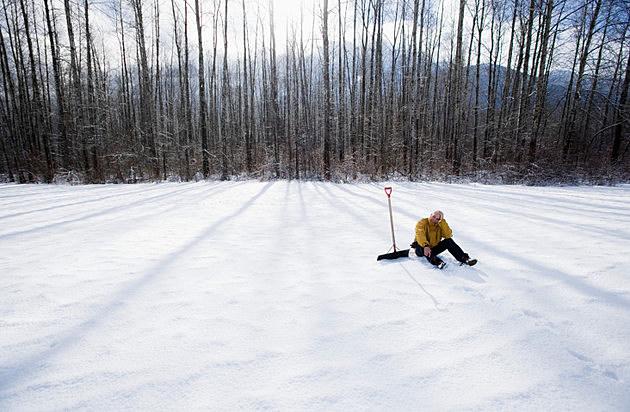 Man with Snow Shovel