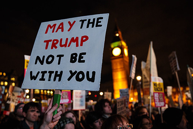 Protesters hold up a placard during a rally in London's Parliament Square