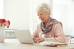 Elderly Woman Typing Something