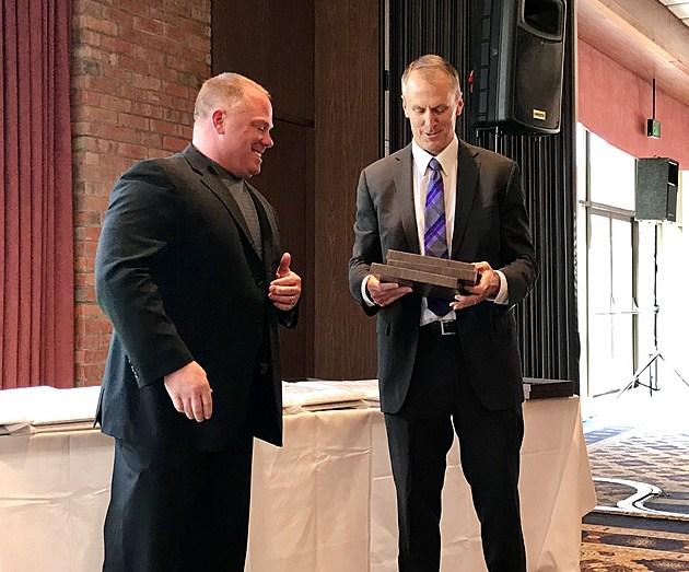 Len Zdanowicz (left) and Steve Bush prepare to award plaques